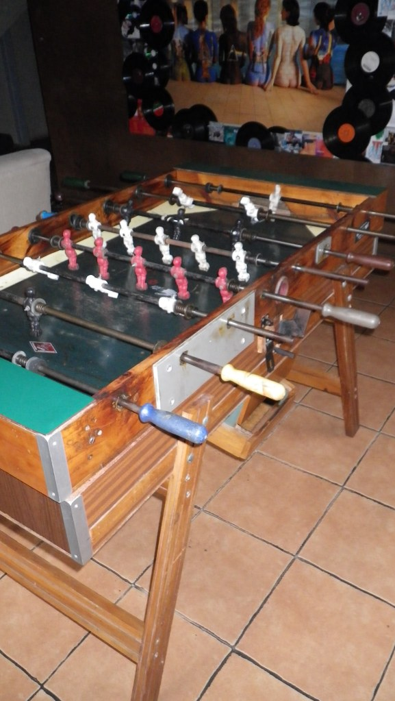 Cool old foosball table at the hostel in San Jose