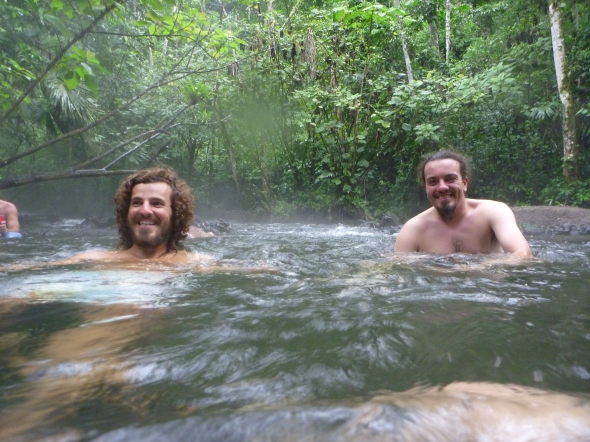 Bro and I in a natural hot spring river near the Arenal Volcano